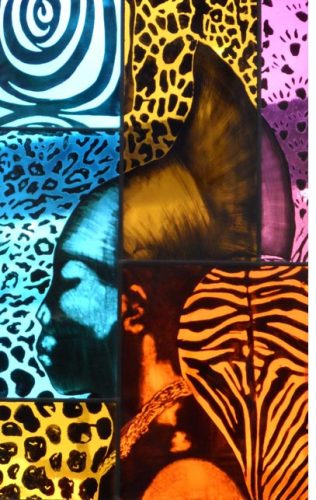 A photograph of a stained glass panel showing the silhouette of a black woman wearing a head dress in profile against a colourful, patterned background