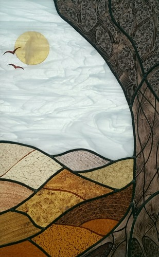 Stained glass panel in browns and white