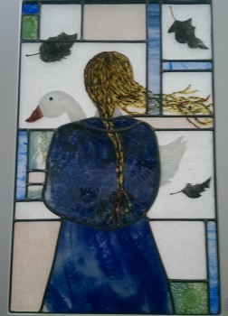 stained glass panel with figure and goose