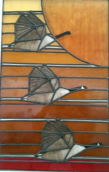 Stained glass panel with three geese