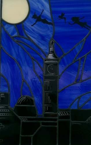 stained glass panel in cobalt blue and black with clock tower