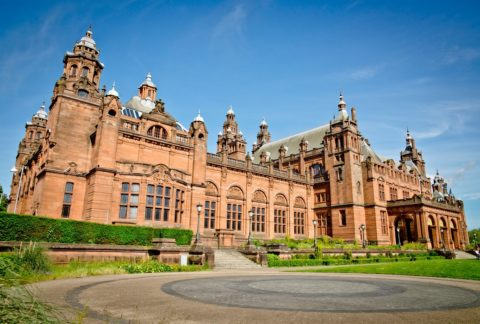 Picture of red sandstone exterior of Kelvingrove Art Gallery and Museum against a blue sky