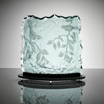 Kiln formed and sandblasted 20mm thick glass with sculpted edge.