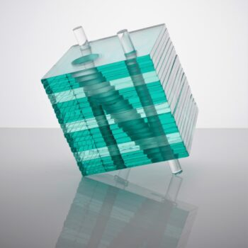 Layered, stacked, drilled float glass. Resting on acrylic rods. Cut, shaped, finished, assembled by hand.