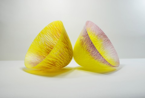 Two yellow and pink slumped glass vessels