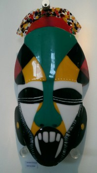 Glass mask in green, white, black, yellow and red